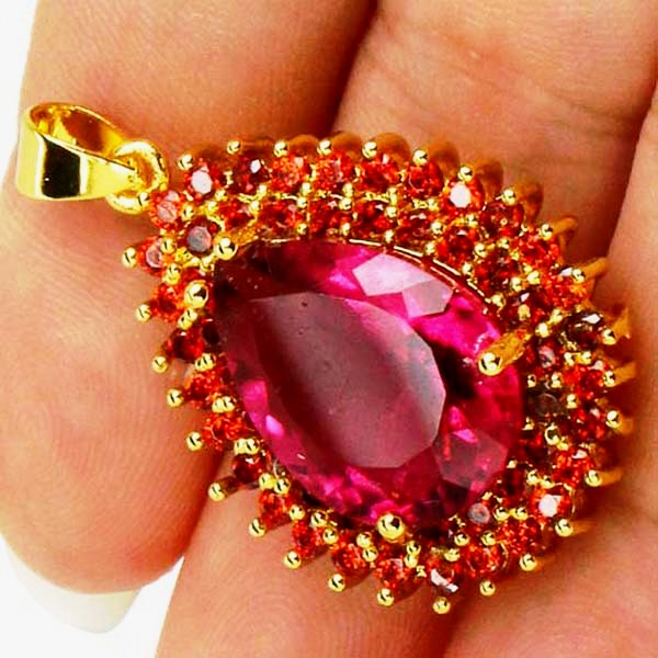 Золотой кулон с розовым турмалином